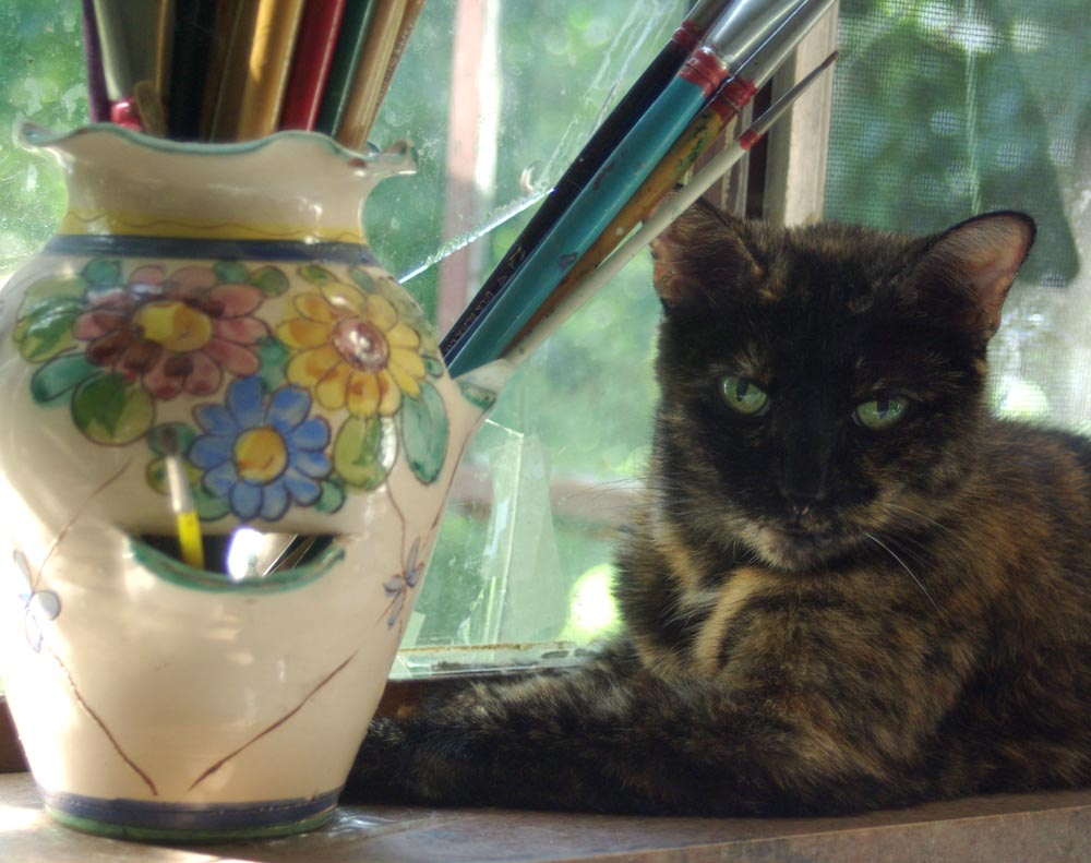 cat with paintbrushes