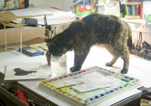 tortoiseshell cat drinking water with watercolors