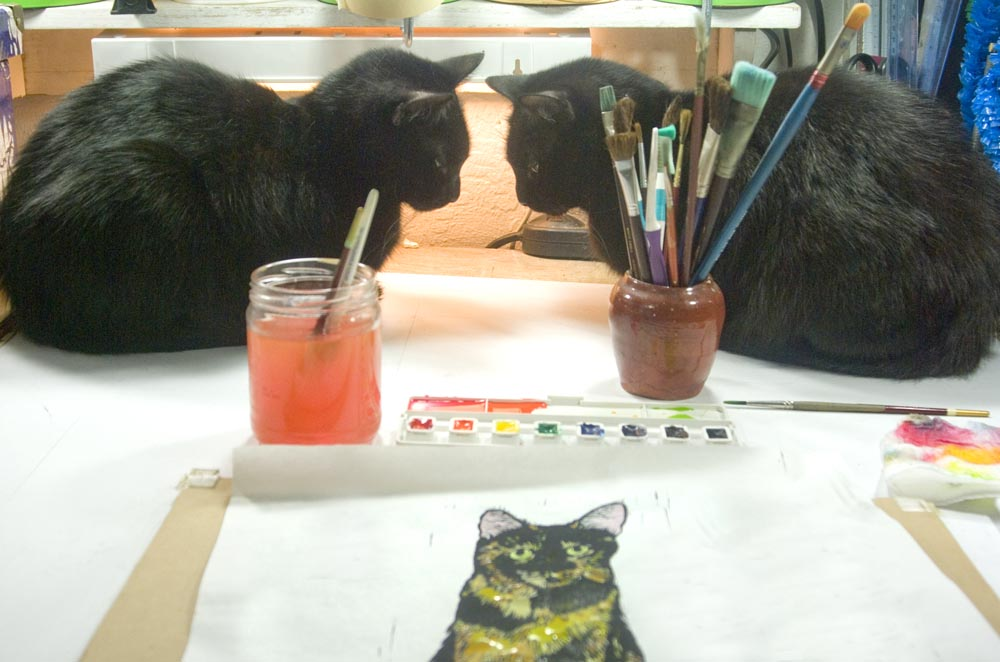 two black cats with painting