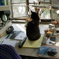 Mimi sits in the center of my desk demanding neatness and just a little personal attention.