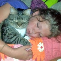 photo of girl and cat