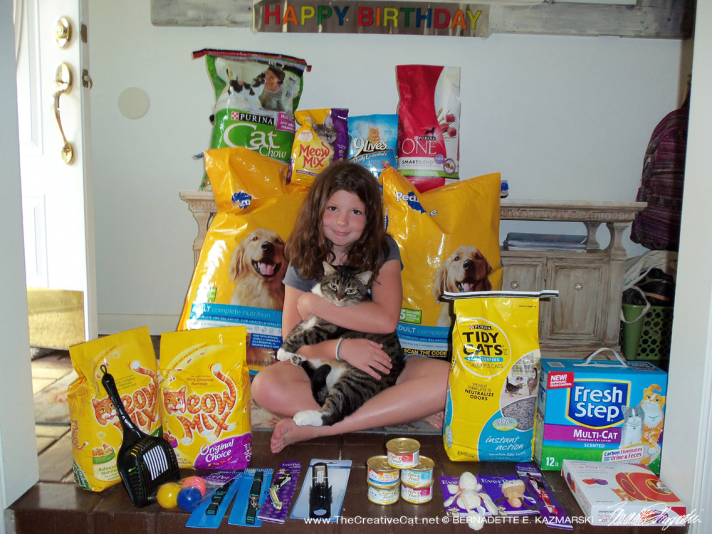 Cassidy with all the loot from her 10th birthday party.