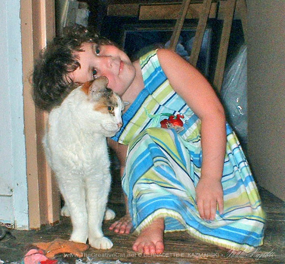 My great-niece Cassidy greets 15-year-old Cream.
