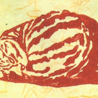block print of curled cat