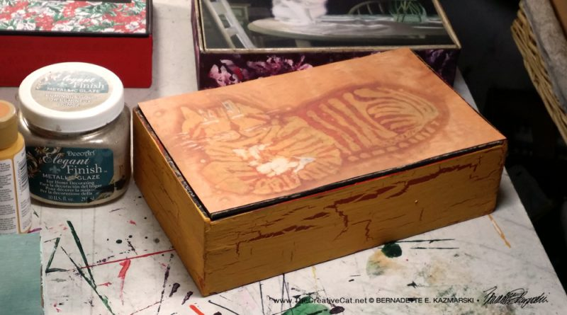 The orange batik kitty was just asking to be on the El Producto box.