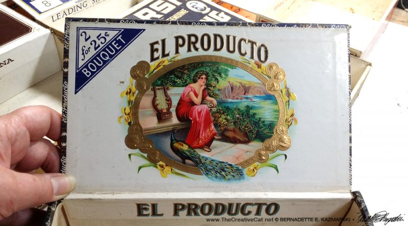 The detailed, colorful and embossed art on the inside of the El Producto box.