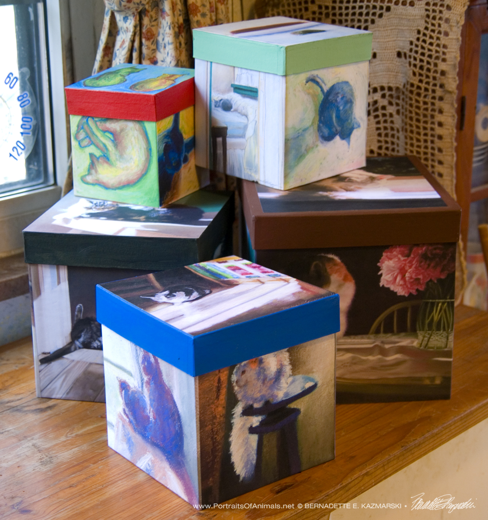 Cube-shaped keepsakes in various sizes feature five themed paintings.