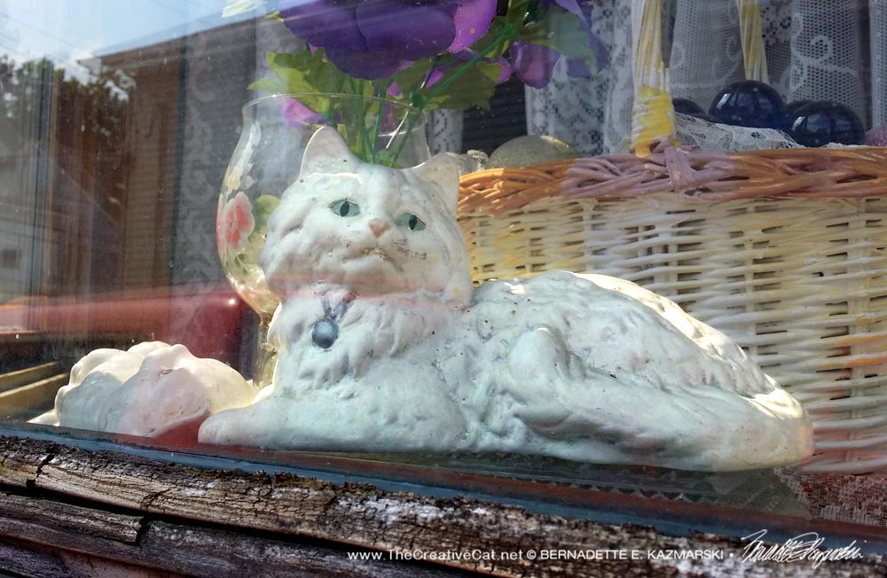 The kitty figurine in the window of the house where Sammy was trapped.