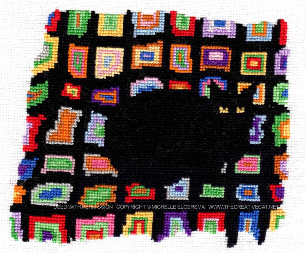 "A cross-stitch made from my sketch ""Mewsette on the Afghan"", created by Dr. Michelle Elgersma."