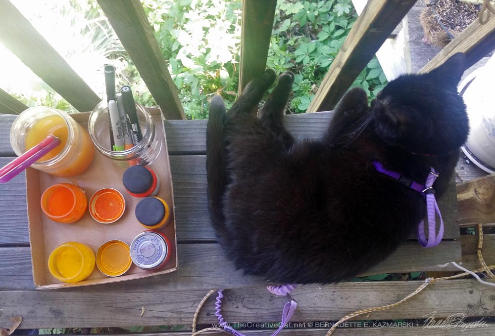 Mimi really is supervising me though it looks as if she's napping next to my paints, inks and brushes.