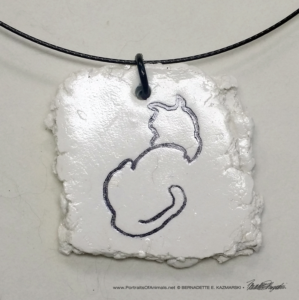 """Back to Front"" pendant, 1.5"" x 1.5"" random on wire cord."