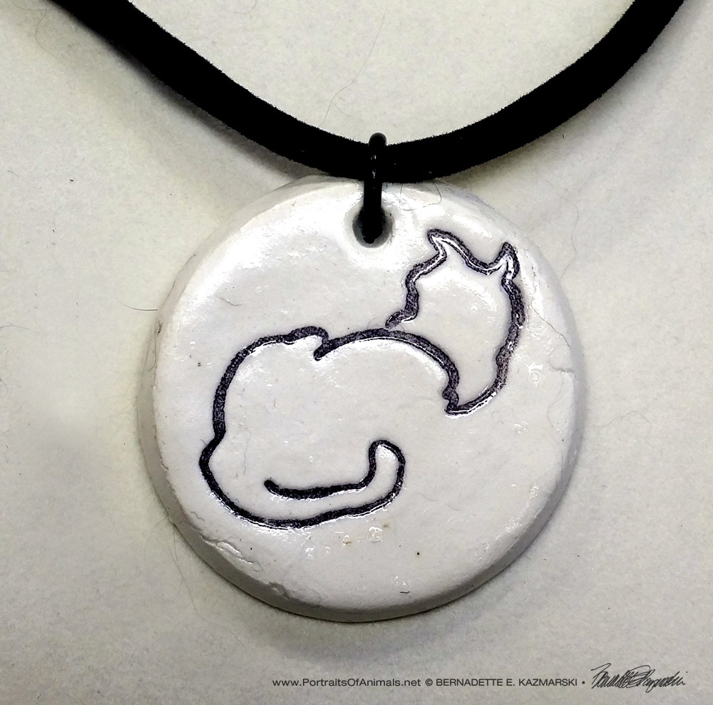 """Back to Front"" pendant, 1"" x 1"" round on flocked cord."