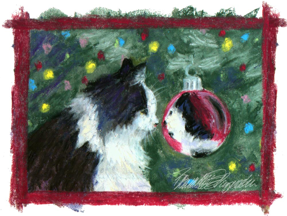 cat looking at holiday ornament