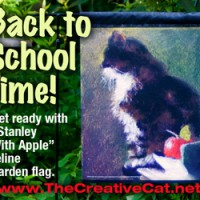 Back to school cat with apple garden flag