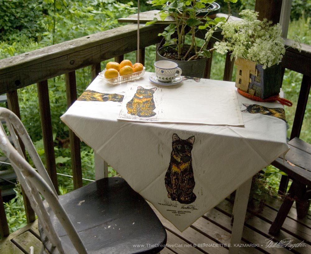 Tortie Girls tableset, The Roundest Eyes tablecloth and place mats.