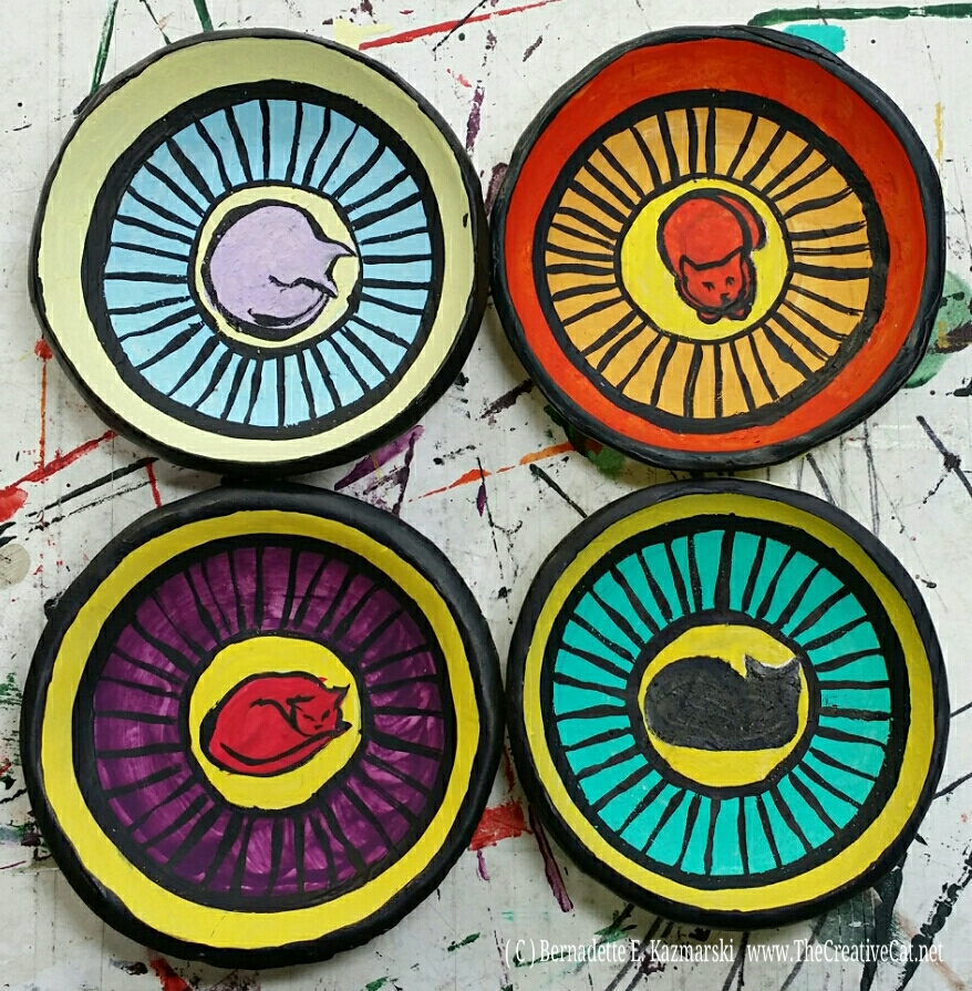 Handmade, hand-painted trinket dishes.
